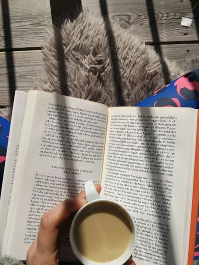 Reading Book Relaxing Sun Spring Balcony Human Hand Drink Table Text Close-up Food And Drink Page Knowledge