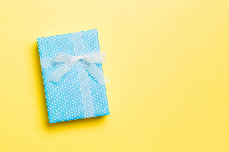 Close-up of blue box against yellow background