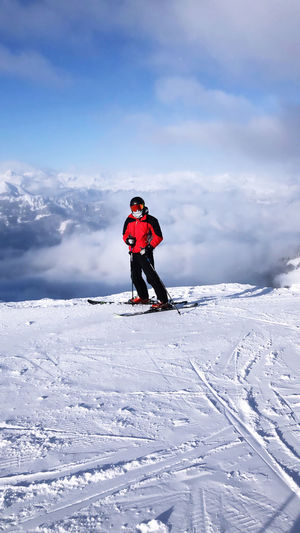 Full length of man on snow covered mountain against sky