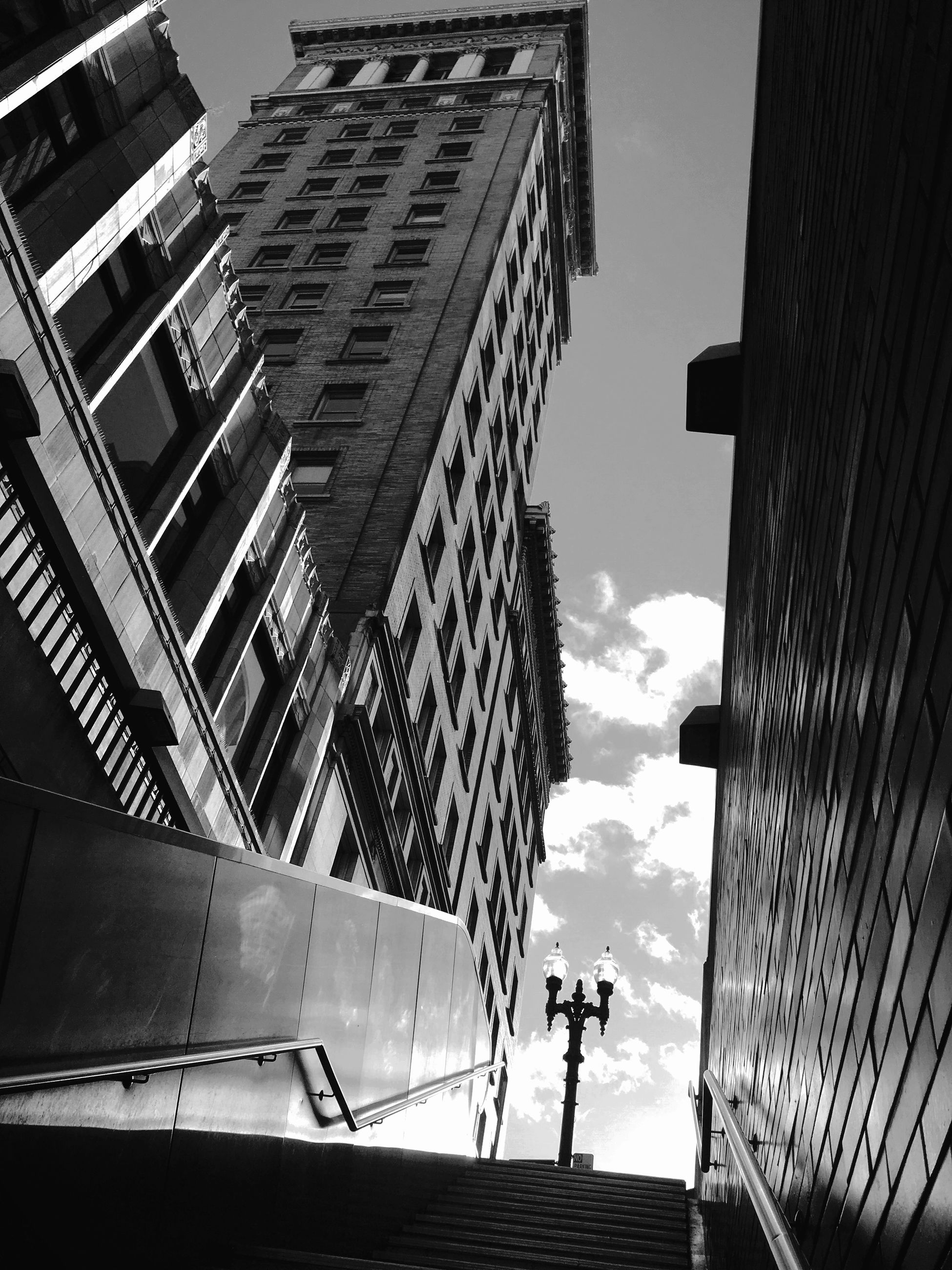 building exterior, architecture, built structure, city, low angle view, sky, modern, skyscraper, office building, tall - high, building, tower, cloud - sky, city life, tall, day, outdoors, cloud, residential building, glass - material