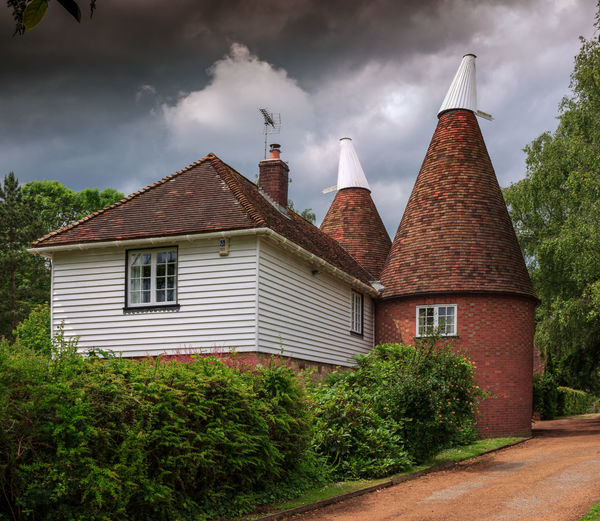 Oast House,Garden of England, Kent, England. Plant Nature No People Built Structure Architecture Building Exterior Outdoors Building Hops Beer Brewing Travel Destinations Tourism Caravan Rural Scene Countryside EyeEm Gallery Vivid International Getty Images Architecture Iconic Buildings Cloud - Sky Sky House Tree Residential District Roof Day Window City Road Smoke Stack