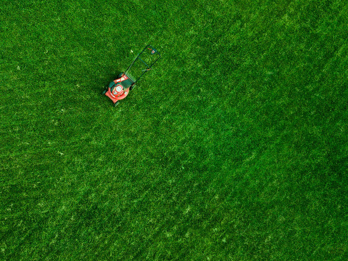 High angle view of lawn mover on grassy field