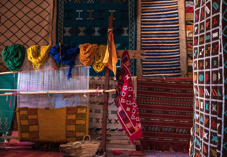 Clothes hanging on rack for sale at market