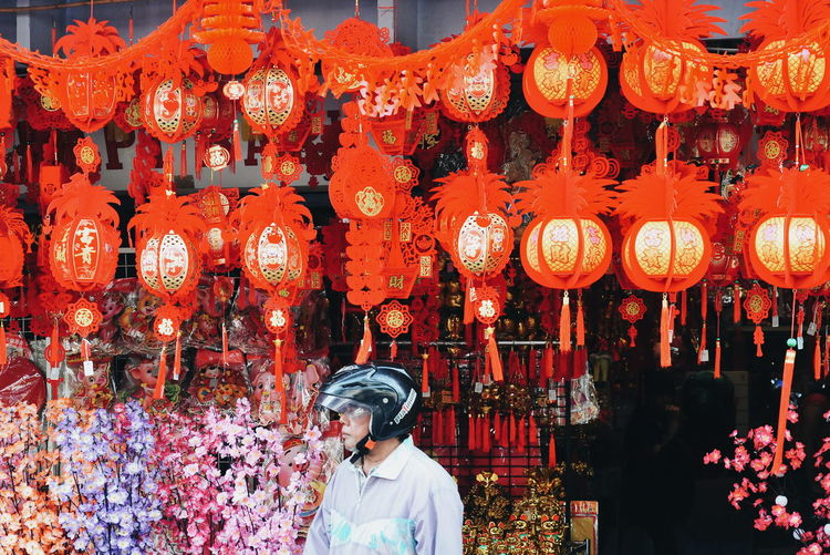 Full frame shot of illuminated lanterns hanging at store