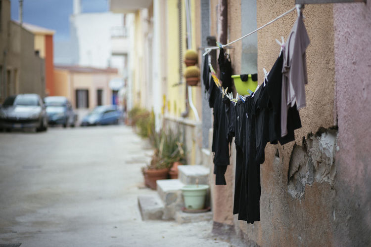 Side View Of Clothes Drying Against The Wall
