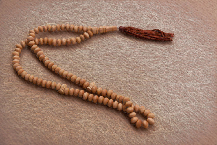 Worry Beads Beaded Beads Brown Brown, Carpe Close-up Contemplation Detail Faith, Belief, Worship, Creed; Sect, Mosque, Cult, Denomination Fringe No People Prayer Beads Reflection Solitude Still Life Wood - Material Worry Beads