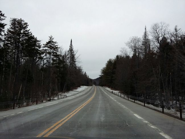 Driving Upstate New York III. · NY USA Road Trip Empty Road Ahead Forest Trees Winter Clouds Cloudy Sky Gray Sky