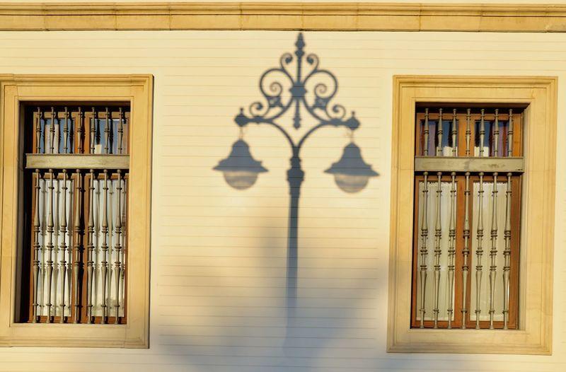 Shadow of street light on building