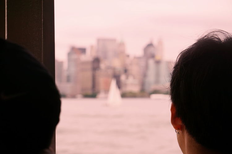 Rear view of people on ferry