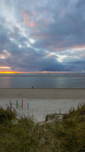 Beach Beauty In Nature Cloud - Sky Clouds And Sky Day Dunes EyeEm Nature Lover Horizon Over Water Island Landscape Langeoog Nature Northsea One Person Outdoors People Reflections Romantic Sky Sea Sky Storm Cloud Sunset Walking Water