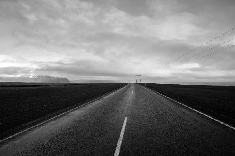 Iceland Iceland_collection Iceland Memories Iceland Trip Icelandic Sky Road Landscape Screensaver Tranquility No People vanishing point Diminishing Perspective Blackandwhite Black And White Road Electricity  Electricity Pylon Cables Mountain Range