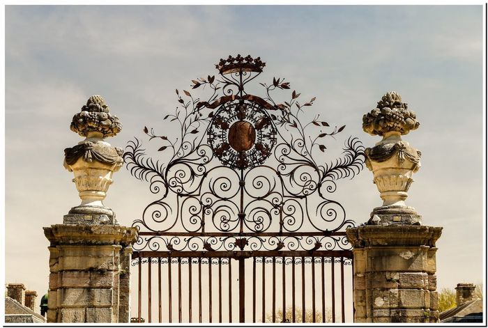 Grille d'entrée Bourgogne Castle Architecture Art And Craft Building Exterior Built Structure Burgundy Château Close-up Day Ferronnerie Gold Colored Low Angle View No People Ornate Outdoors Sculpture Sky Statue Travel Destinations First Eyeem Photo