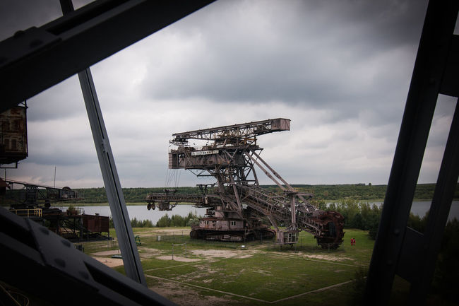 Brown Coal Mine Architecture Beauty In Nature Brown Coal Surface Mining Area Built Structure Cloud - Sky Day Ferropolis Land Vehicle Landscape Mining Mode Of Transport Nature No People Open-cast Mining Outdoors Sky Transportation Water