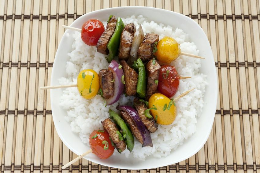 Skewers of chicken and vegetables with rice. Healthy Eating Food Directly Above No People UnykaProductions Skewers Skewered Food Skewered Chicken Chicken Studio Photography Yellow Cherry Tomato Scallions Multi Colored Cherry Tomatoes Porcelain  Grilled Red Onion Green Pepper Rice Natural Light Asian Style Food Stories