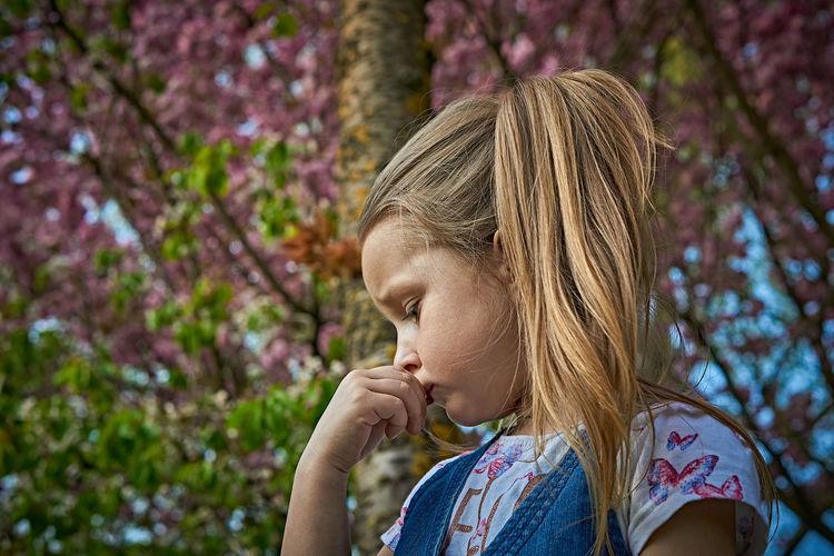 Cute Girl Against Tree