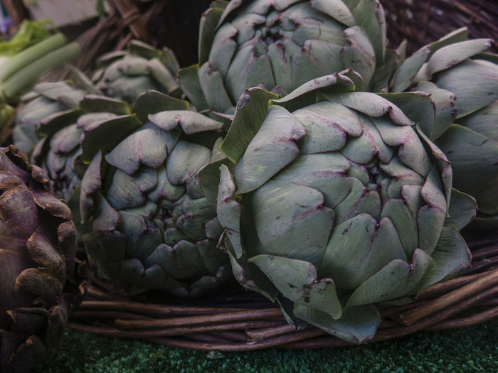 High angle view of artichokes in basket for sale at market