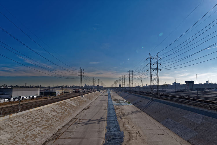 Mechanical River. Pentax PENTAX K-1 Pentax 15-30 F/2.8 Wide Angle San Francisco California Bay Area USA Rail Transportation Symmetry Pylon Concrete Water Blue Sky Lens Flare River Cable Sky Electricity Pylon Transportation Electricity  Outdoors No People Architecture Day California Dreamin