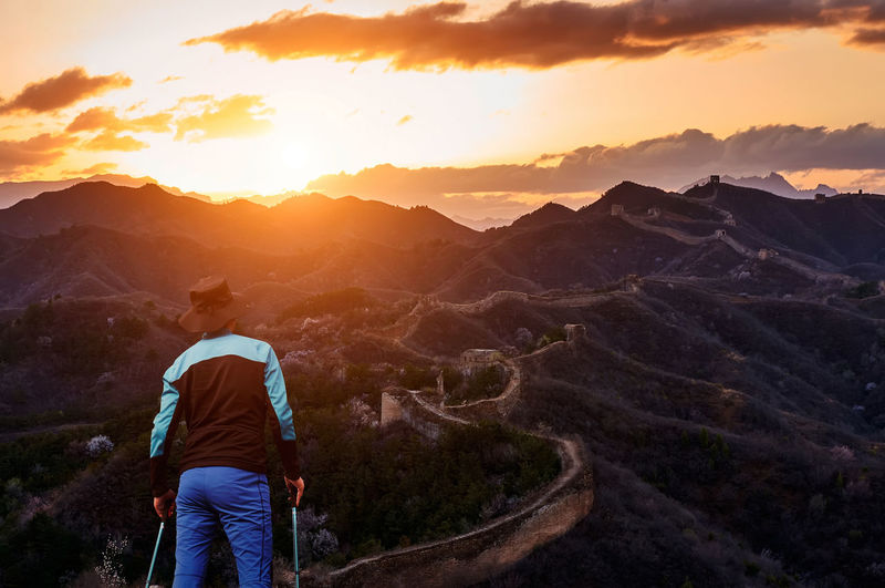 Travel on the Great Wall Architecture Beijing Great Wall Great Wall Of China Travel Traveling Beauty In Nature China Culture Great Wall Of China Tower History Landmark Landscape Looking At View Men Mountain Mountain Range Nature Old One Person Oriental Real People Rear View Scenics - Nature Sunrise