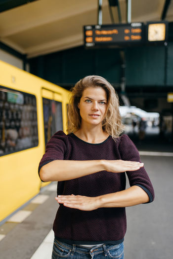 Portrait of beautiful woman standing in bus