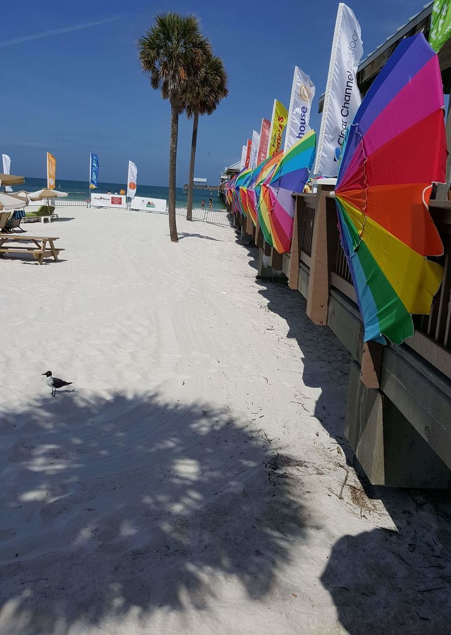 beach, sand, multi colored, shadow, sunlight, day, nature, sea, outdoors, no people, sky, beauty in nature, water