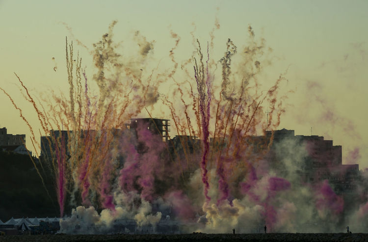 Neversea 2018 Fireworks Air Pollution Architecture Building Exterior Built Structure Cloud - Sky Day Emitting Environment Environmental Issues Firework - Man Made Object Nature No People Outdoors Pollution Sky Smoke Smoke - Physical Structure Sunset Tree