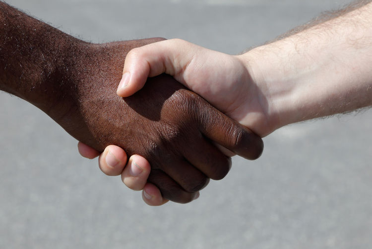 Diverse men shaking hands African Agreement Bonding Caucasian Close-up Concept Connection Cooperation Day Diverse Friendship Handshake Human Body Part Human Hand Men Outdoors People Real People Teamwork Togetherness Two People Unity