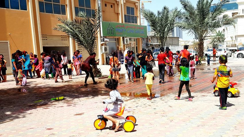 Holi 2017 in UAE.. Indian's celebrating holi with colours and coloured water.. Large Group Of People Celebration Adult Tree Real People Lifestyles Outdoors Casual Clothing Refreshment