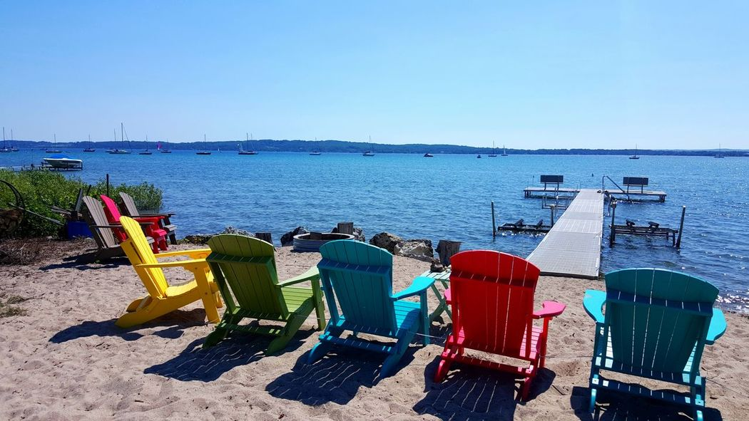 Beach Chairs Bay Lake Water Blue Sky Blue Water Summer Sun Daylight 45th Parallel Michigan Boats Sailboats Tranquil Scene Landscape Tranquility Summer Vibes Relaxing No People