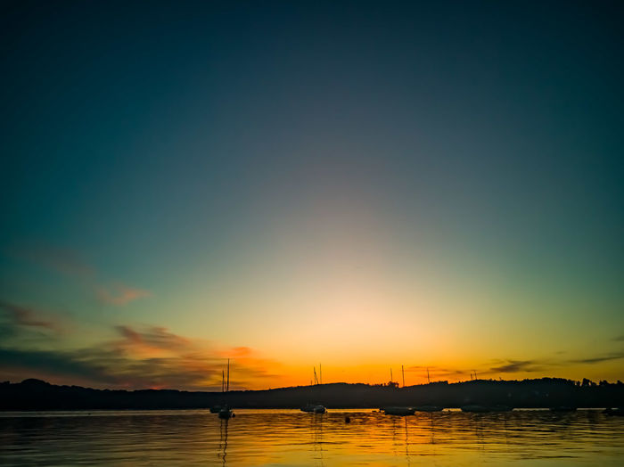 Sunset am Attersee Nature Graphxart Attersee Austria Photography Photooftheday Water View Into Land Nautical Vessel Sea Sunset Horizon Silhouette Blue Reflection Low Tide Romantic Sky Moody Sky Majestic Dramatic Sky Seascape Idyllic Sky Only