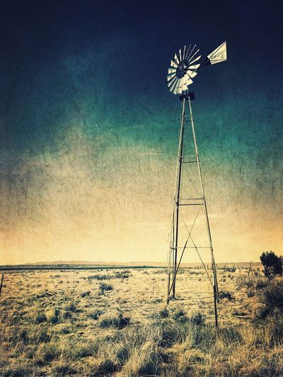 """""""Where The Wind Blows"""" A lone windmill stands on the open plains near Carrizozo, NM. Desolate New Mexico Photography New Mexico Skies New Mexico Alternative Energy Wind Power Wind Turbine Windmill Renewable Energy Traditional Windmill Outdoors No People Rural Scene"""