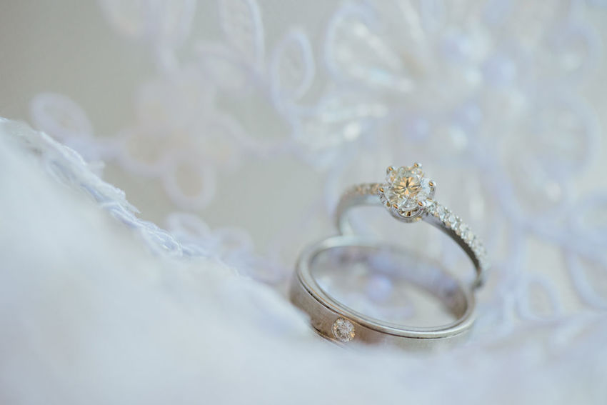 Two Wedding rings On white lace. Couple Valentine Wedding Close-up Couple - Relationship Engagement Rings Indoors  Jewelry Luxury Marriage  No People Ring Rings Two Rings Wedding Ceremony Wedding Ring White Lace White Lace Background