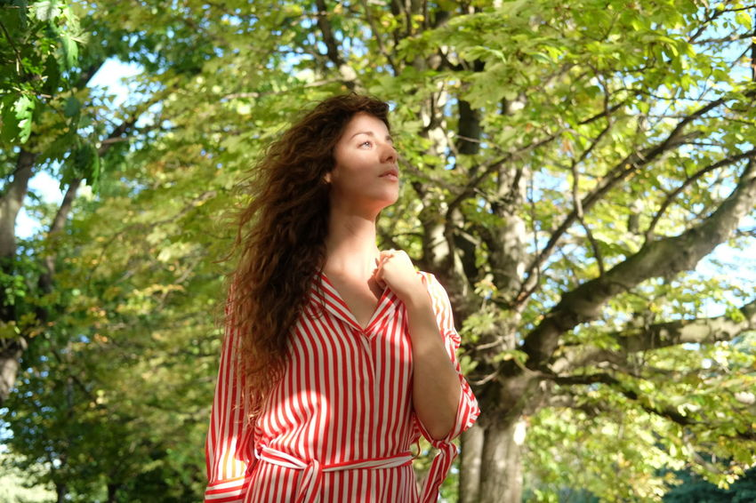 summer stroll model Julia Bond Adult Beautiful Woman Brown Hair Casual Clothing Contemplation Day Hair Hairstyle Human Hair Long Hair Looking Low Angle View Nature One Person Outdoors Plant Standing Striped Tree Waist Up Young Adult Young Women