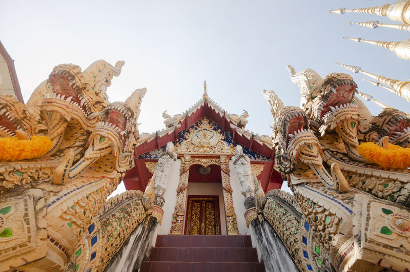Low angle view of temple entrance against sky