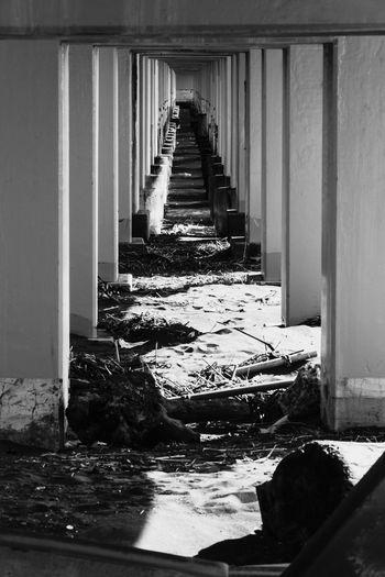 Dead end. Sea Pentax Shadows Sun High Bridge Monochrome Sand Continuous Photographyislife Pillar Water Architectural Column Architecture