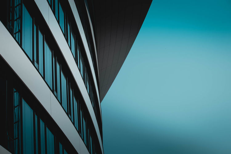 Built Structure Building Exterior Architecture Office Office Building Exterior Low Angle View City Building Modern No People Clear Sky Sky Blue Day Nature Glass - Material Reflection Outdoors Copy Space Skyscraper Directly Below