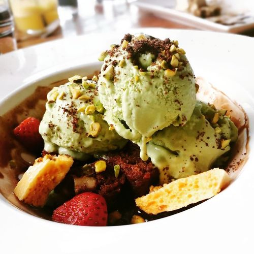 Avocado ice cream with chocolate brownies Egg Poached Savory Food Plate Breakfast No People Frozen Food Ice Cream Ready-to-eat Close-up Food Freshness Day Outdoors Avocados Avocadoicecream Brownies Strawberries Honeycomb