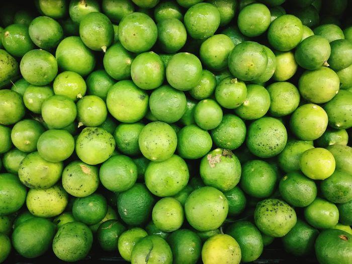 Full frame shot of green citrus fruit for sale in market