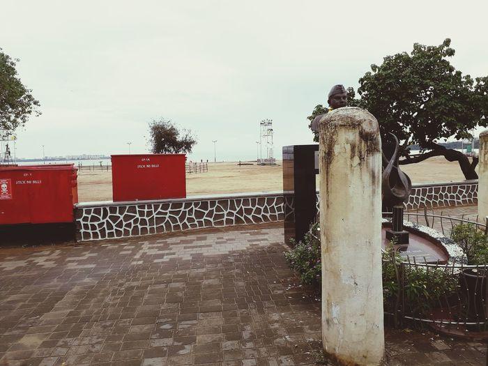 Text on railing against clear sky