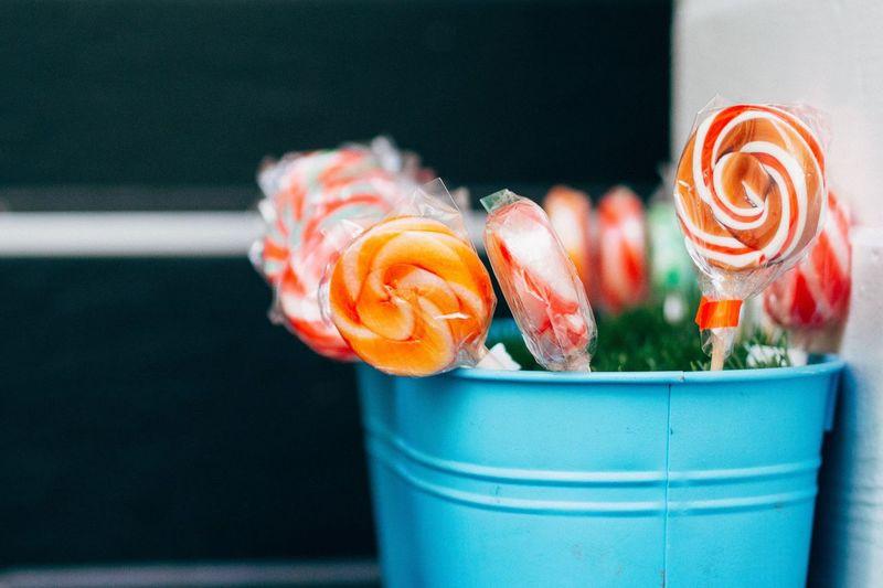Close-up of lollipops in bucket