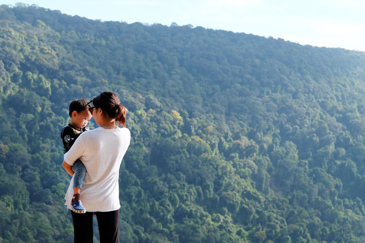 Rear View Of Couple Looking At Mountain Landscape