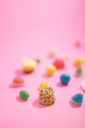 Baked Cake Candy Choice Colored Background Dessert Food Food And Drink Icing Indoors  Indulgence Multi Colored No People Pink Background Pink Color Snack Studio Shot Sweet Sweet Food Temptation Unhealthy Eating Variation
