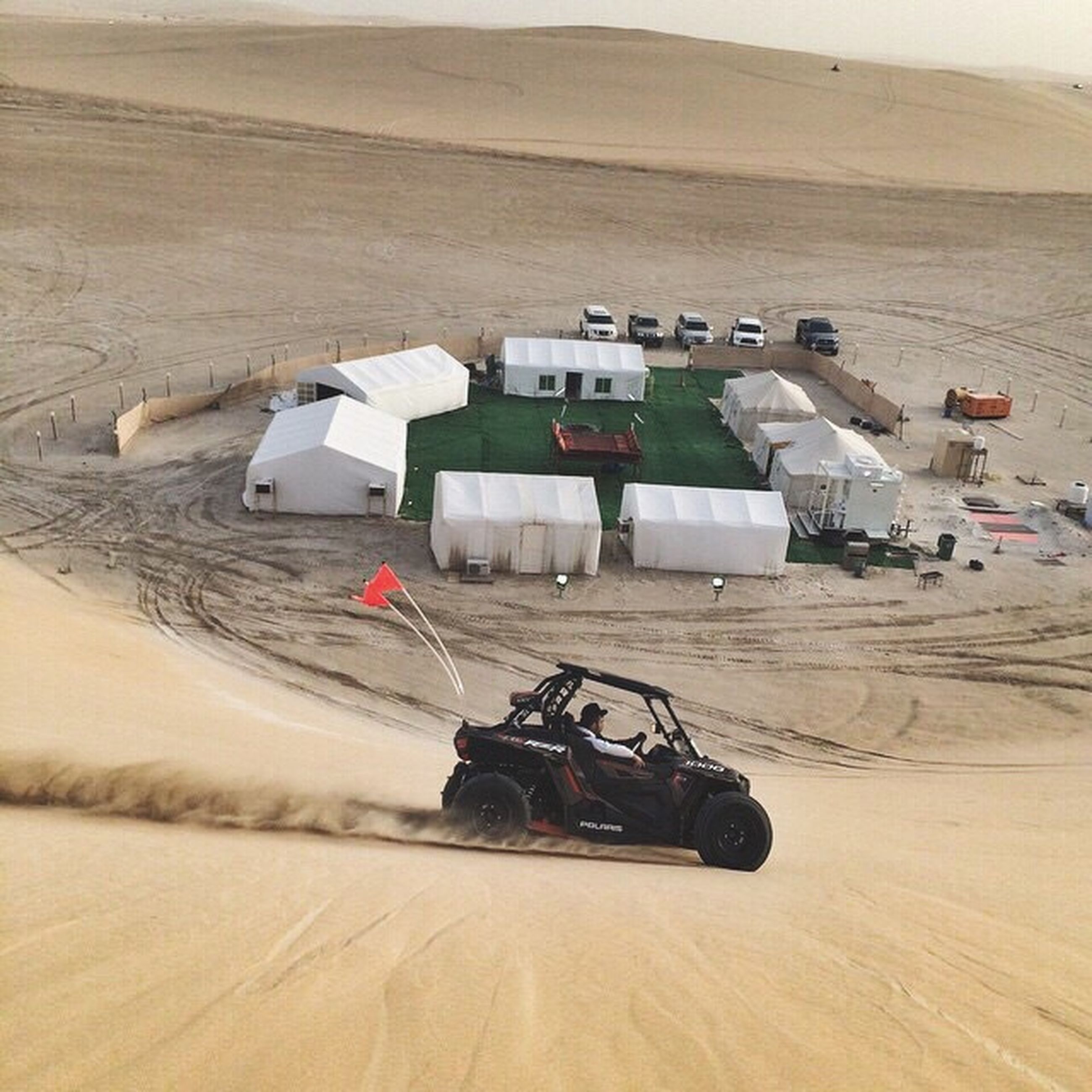 transportation, land vehicle, mode of transport, landscape, car, travel, high angle view, sand, day, desert, field, outdoors, mountain, leisure activity, sunlight, stationary, nature, men