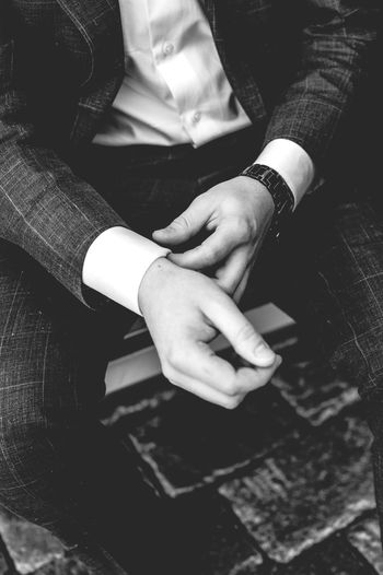 Midsection of man wearing suit