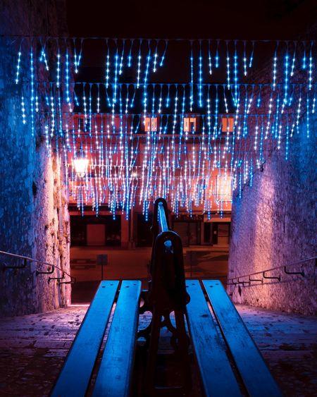 Man standing in illuminated room
