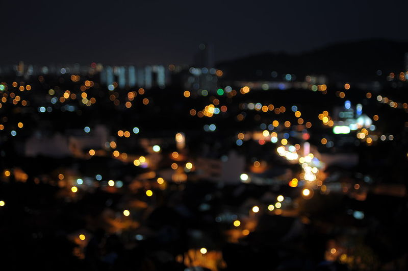 High angle view of illuminated city at night