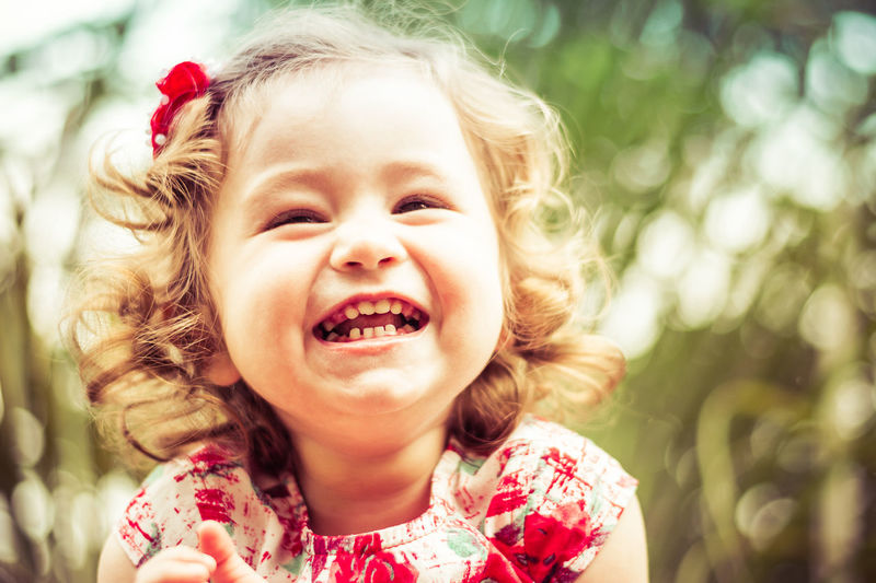 Close-up of cheerful girl on sunny day
