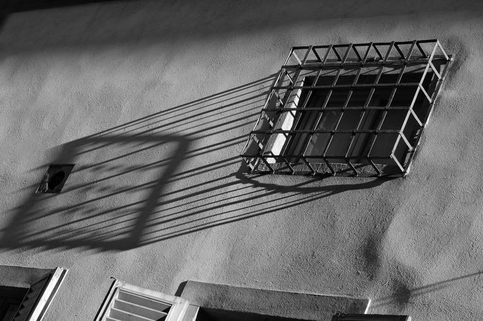 window grill High Angle View Shadow Day Sunlight No People Window Grill Outdoors Window Protection Security Security Grill Monochrome Black And White Shadows Shadows & Light City Travel Contrast Casting A Shadow