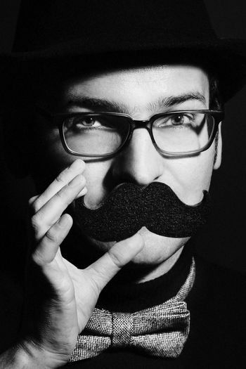 Mr Jones and his sponge mustache. Adult Black & White Black And White Black And White Photography Black Background Blackandwhite Blackandwhite Photography Close-up Day Eyeglasses  Front View Goodfeelography Human Body Part Human Face Human Hand Indoors  Lifestyles Makeportraits Moustache One Person People Portrait Portrait Photography Real People Young Adult