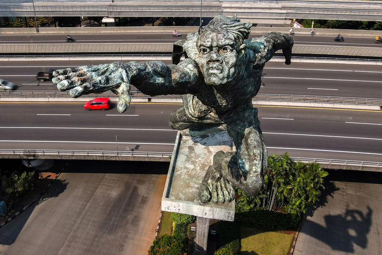 Statue against road in city
