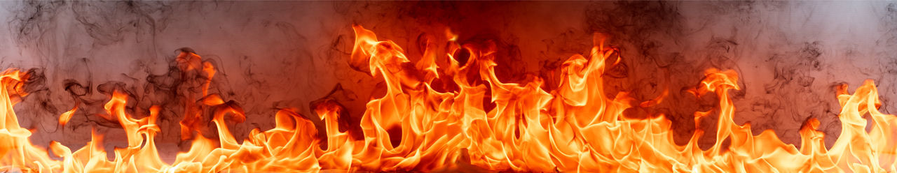 Close-up of fire against orange sky